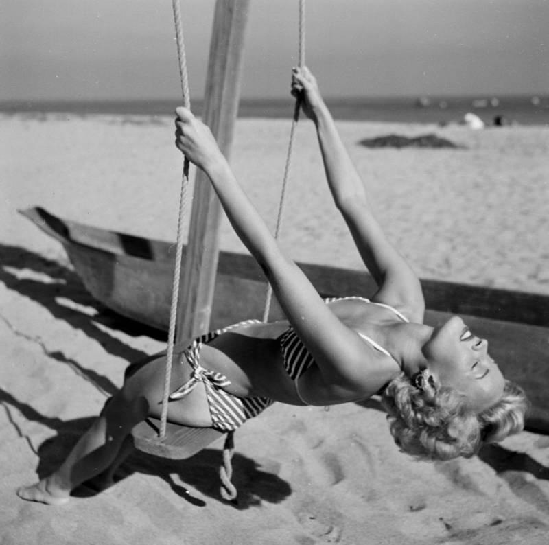 Swinging On Beach