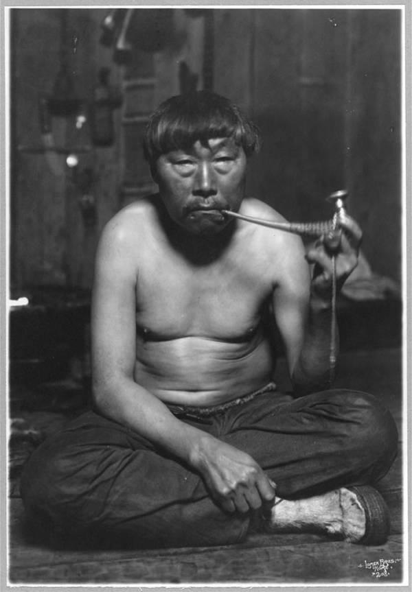 Alaskan Man Smoking Pipe