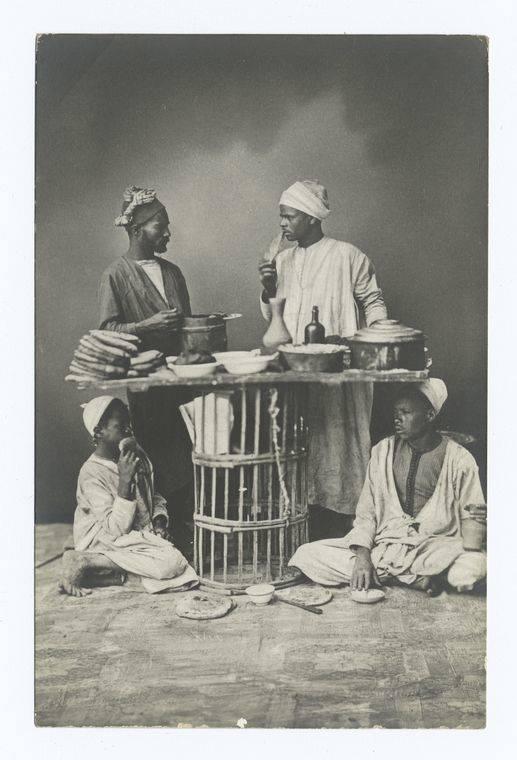Bedouin Men At Dinner