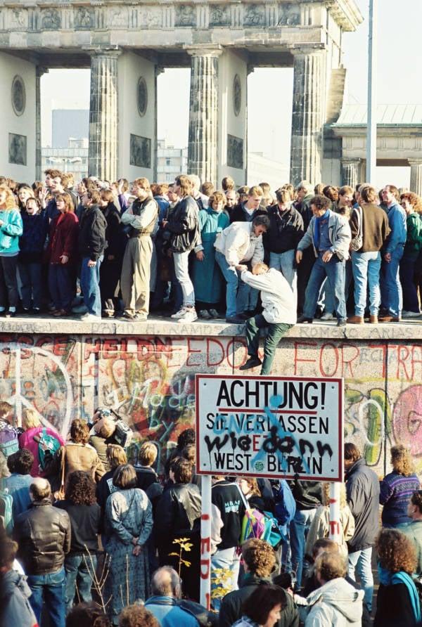 Berlin Wall Helping Climb