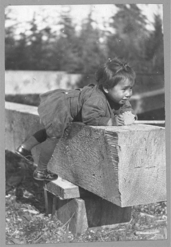 Child On Wood Block