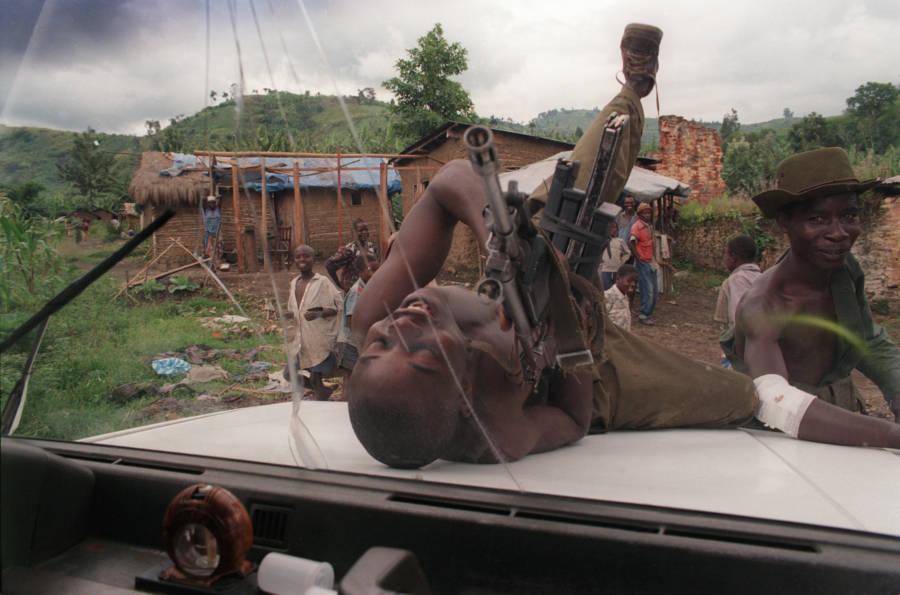 Congo Child Soldier Playing With Gun