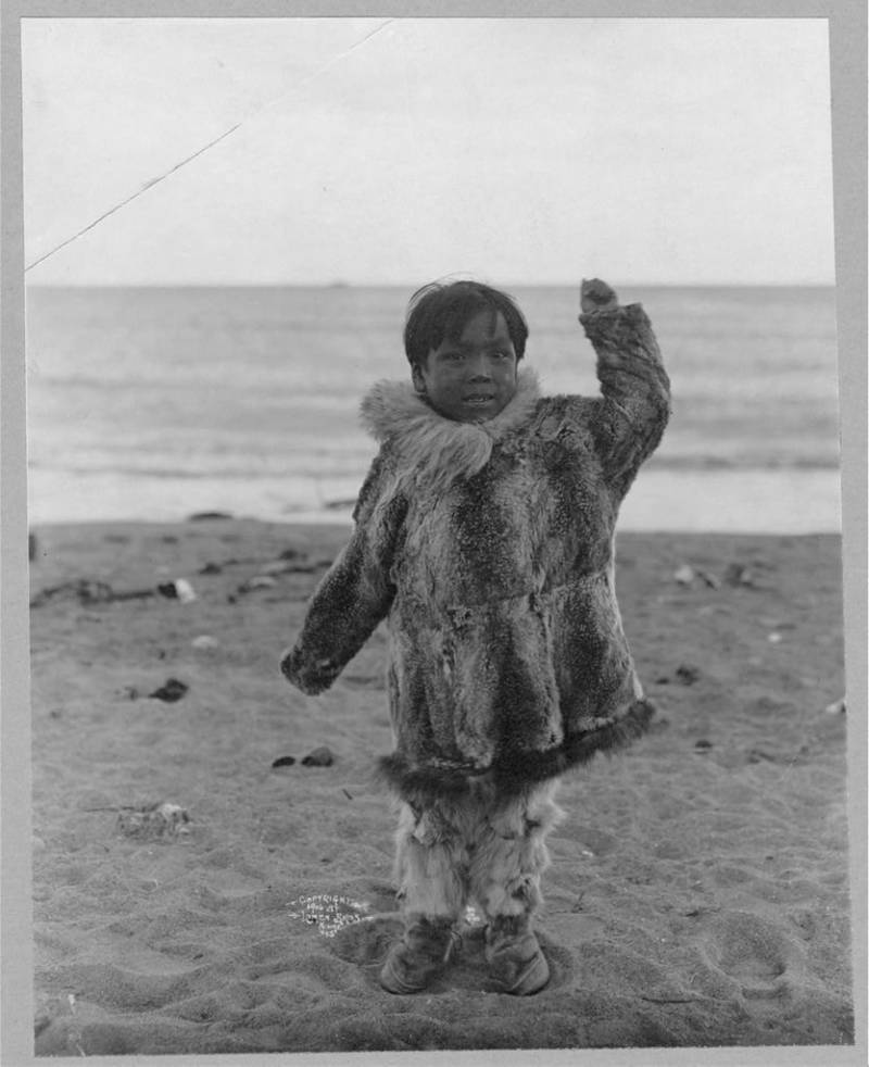 Eskimo Boy On Beach
