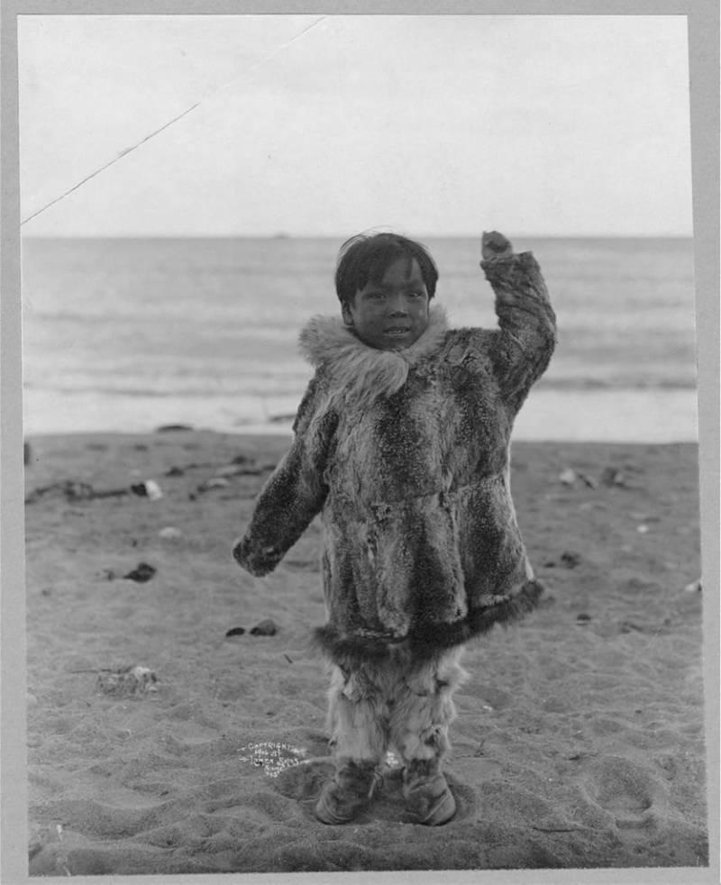 Eskimo Boy On Beach
