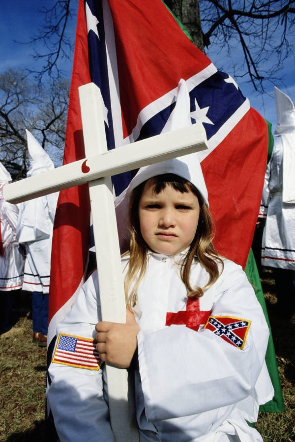 Girl Holding Kkk Cross