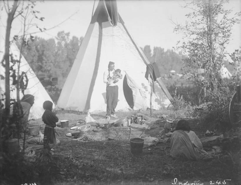 Holding Child Outside Tepee