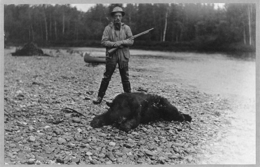 Hunter With Bear