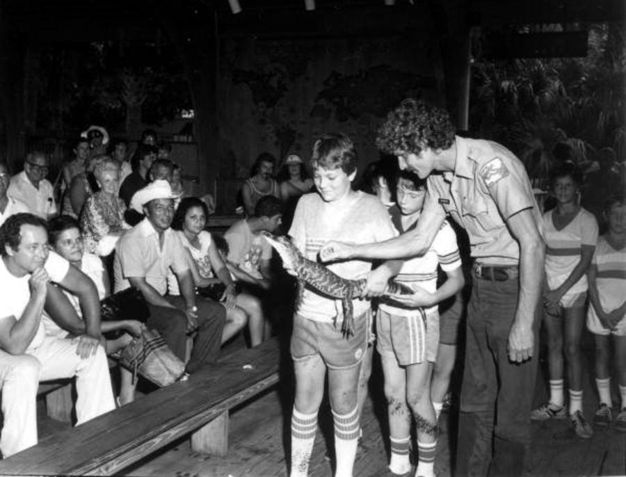 Kids Holding Alligator