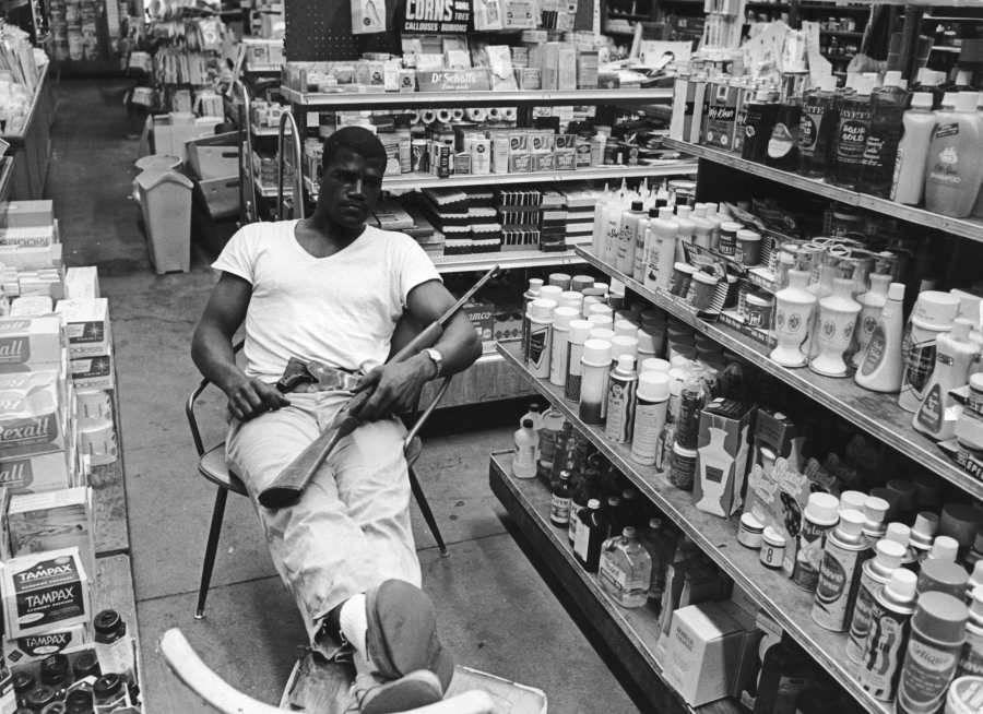 Man Guarding Store