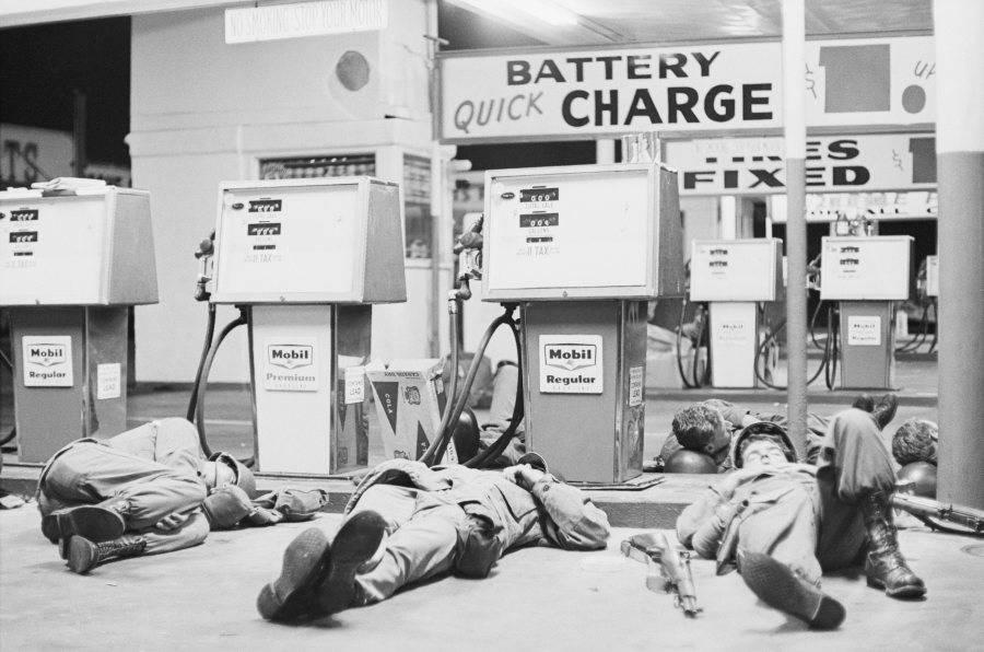 National Guardsmen Sleeping Near Gas Pumps