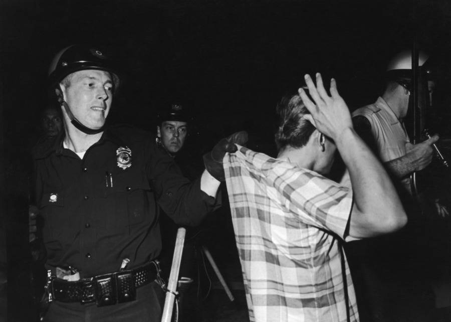 Officer Grabbing Shirt