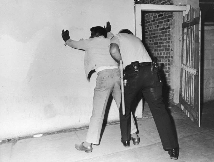 Officer Patting Down Suspect