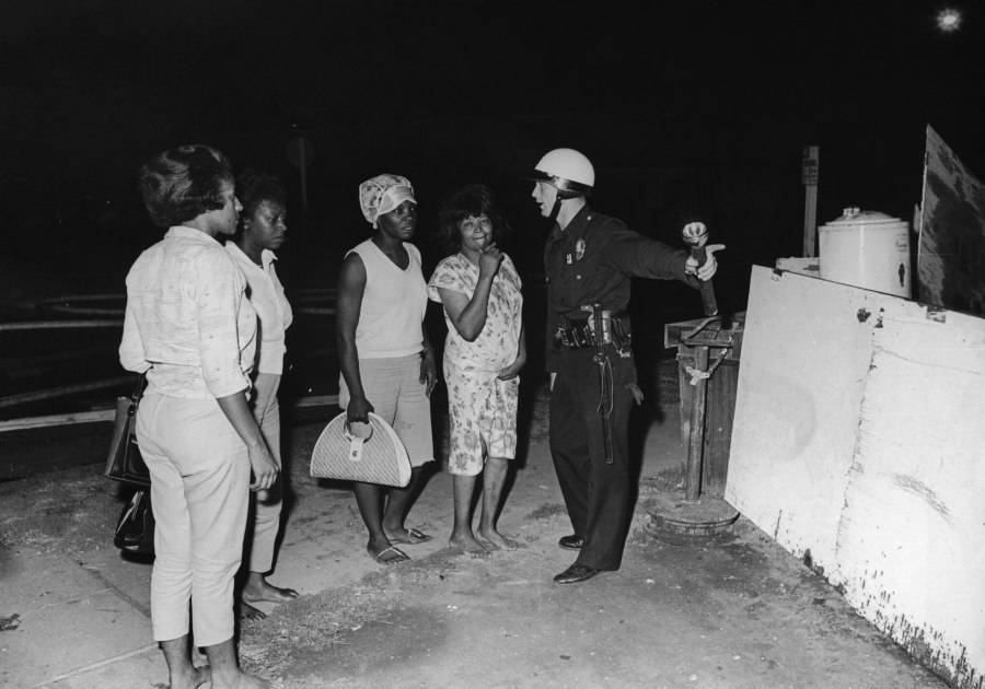 Officer Pointing With Ladies