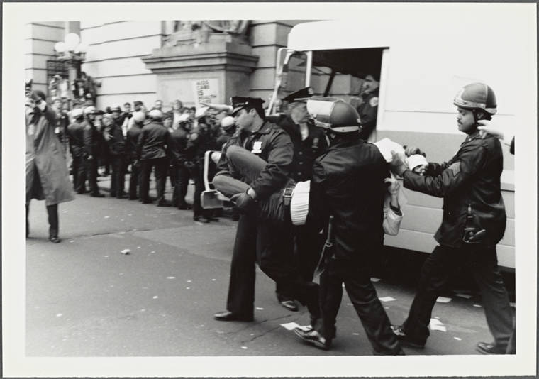 Police Carrying Protester