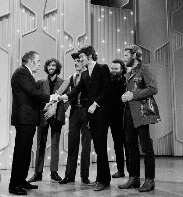 The Band Shaking Hands Sullivan