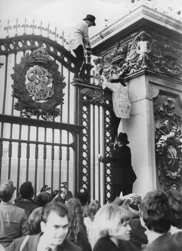 Beatlemania Fans Climb Buckingham