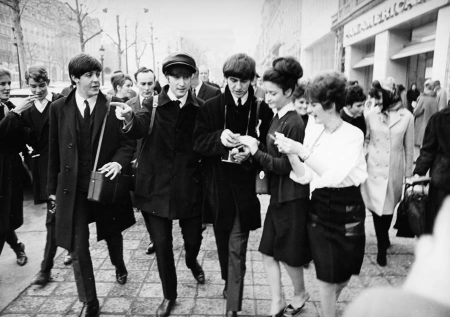 Beatles Signing Autographs
