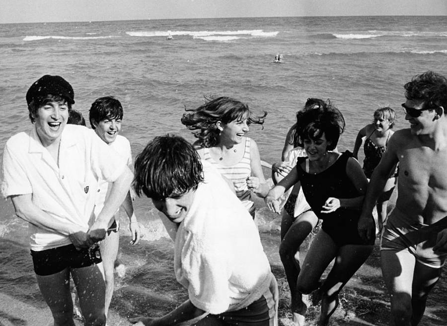 Beatles Surrounded By Fans