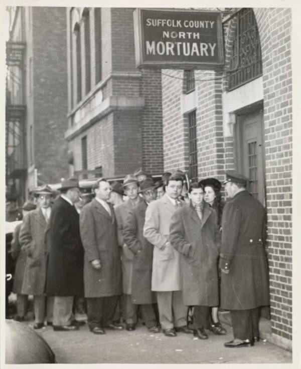 Crowd Outside A Mortuary