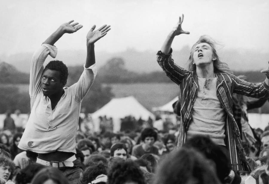 Hippies Dancing At Festival