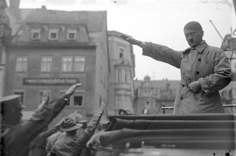Hitler Salutes His Supporters