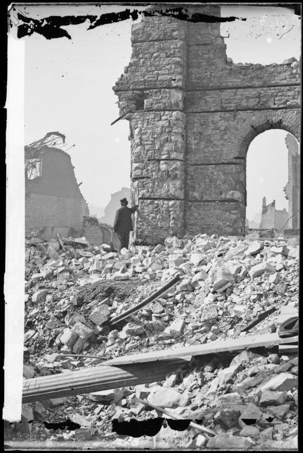 Man Beside A Ruined Building Hat