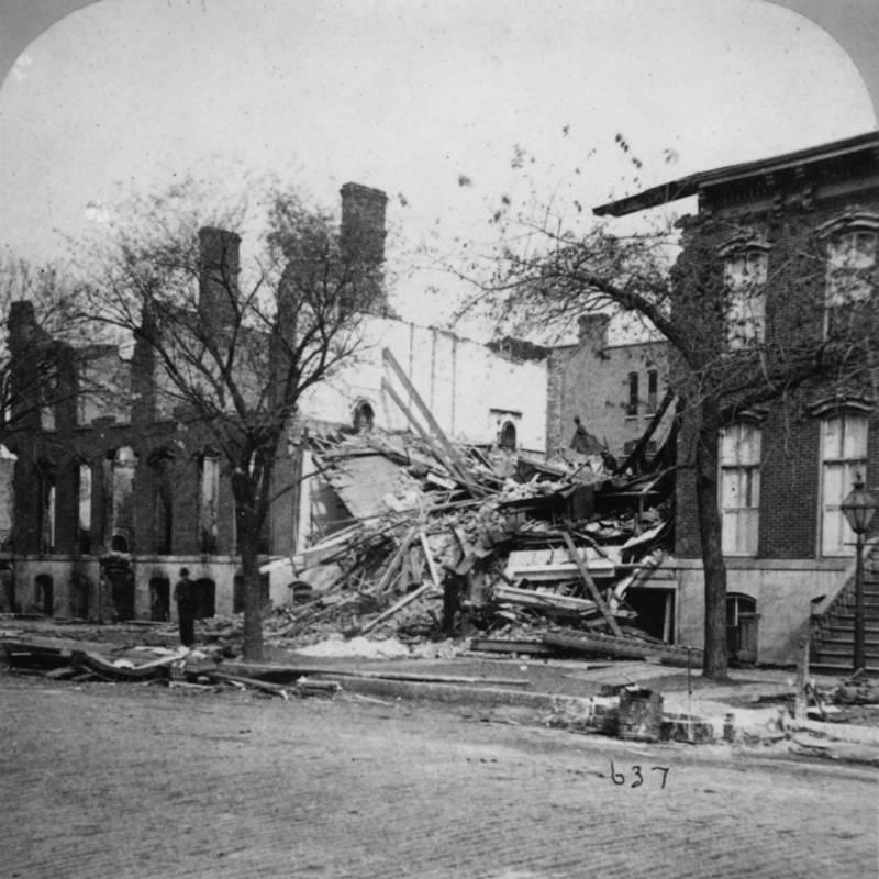 Man Beside Ruined Building