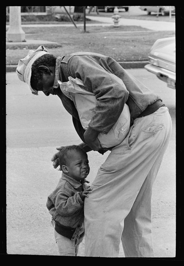 Old Man Comforting Child