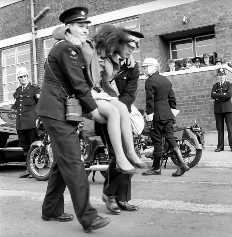 Police Carrying Beatles Fan