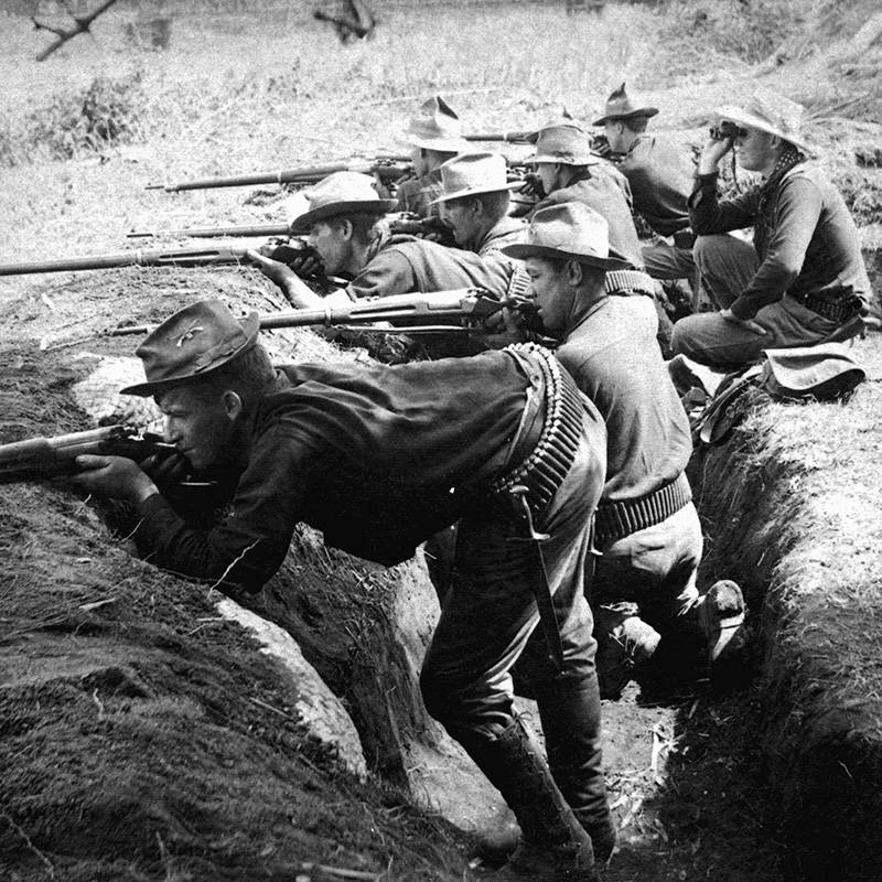 Soldiers Fire From Trenches