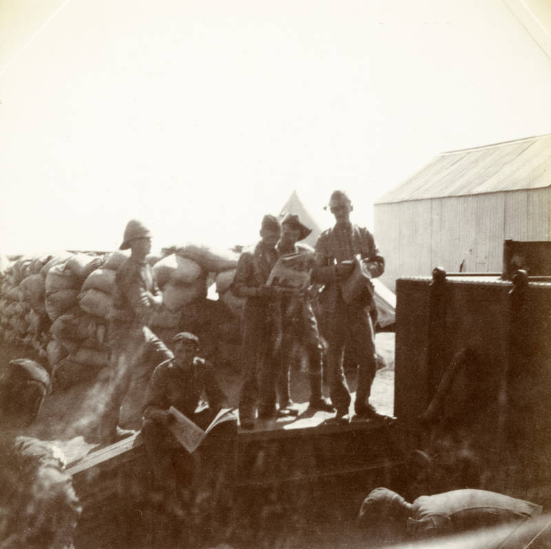 Soldiers Reading Papers