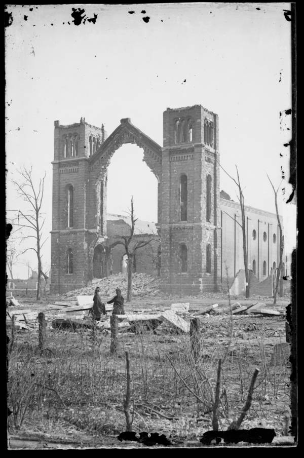Two People Looking At Ruins