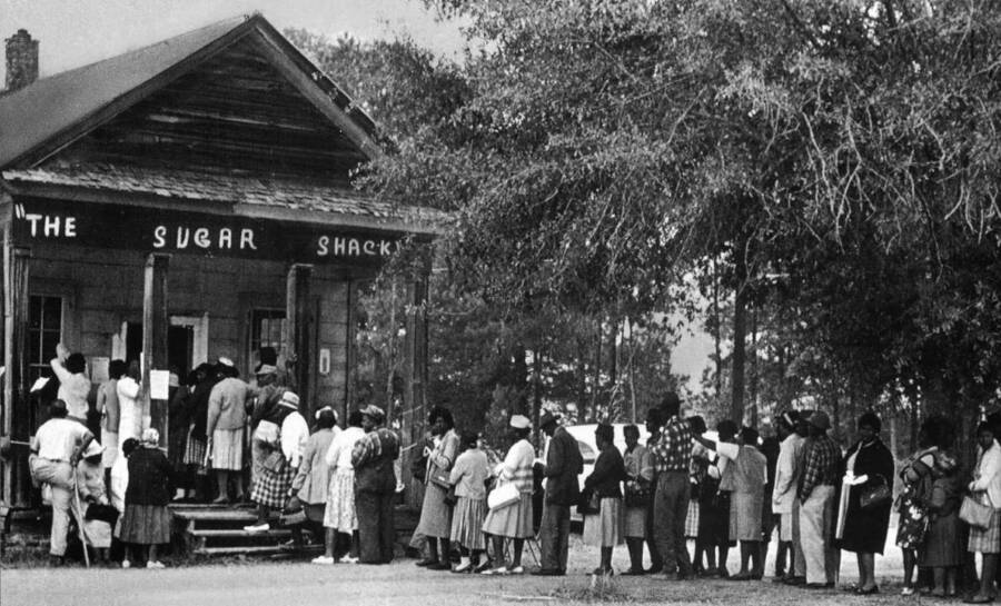 African Americans Lining Up To Vote Outside A Shack