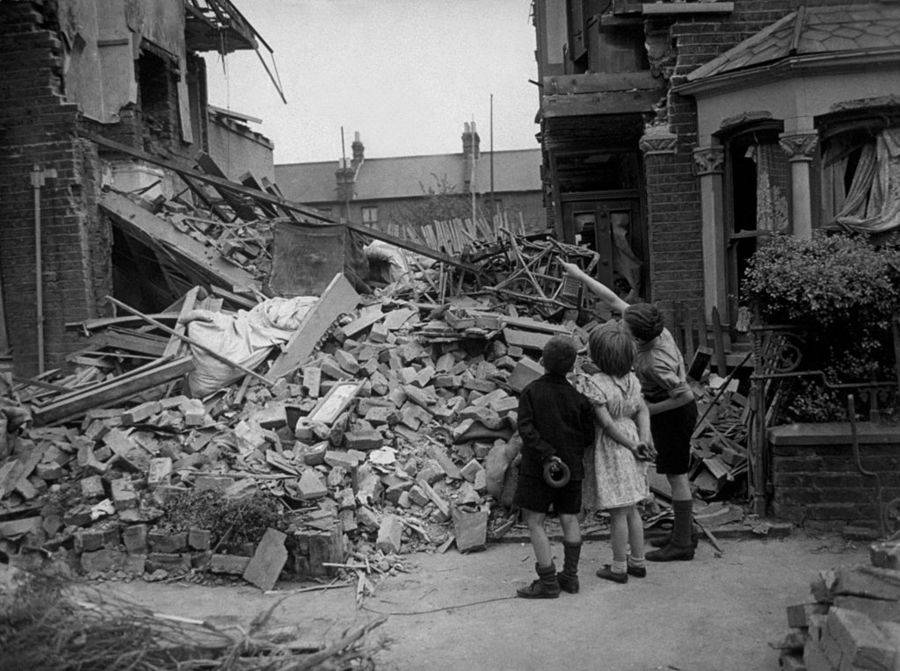 Boy Pointing Out His Bedroom Before It Was Bombed