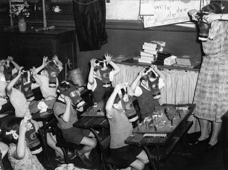 Children Being Taught How To Put On A Gas Mask