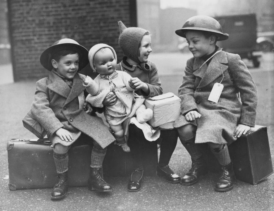 Children Sitting On Luggage