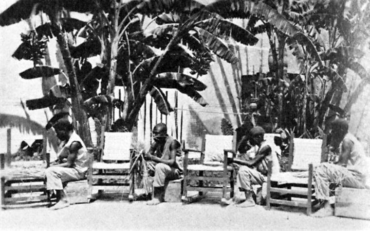 Prisoners making chairs