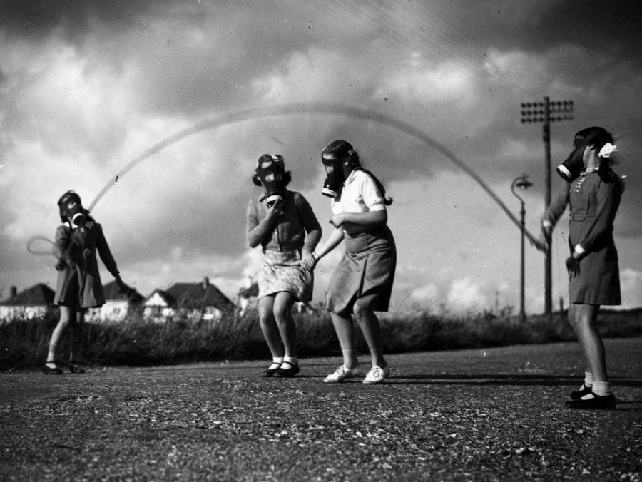 Girls Wearing Gas Masks Playing
