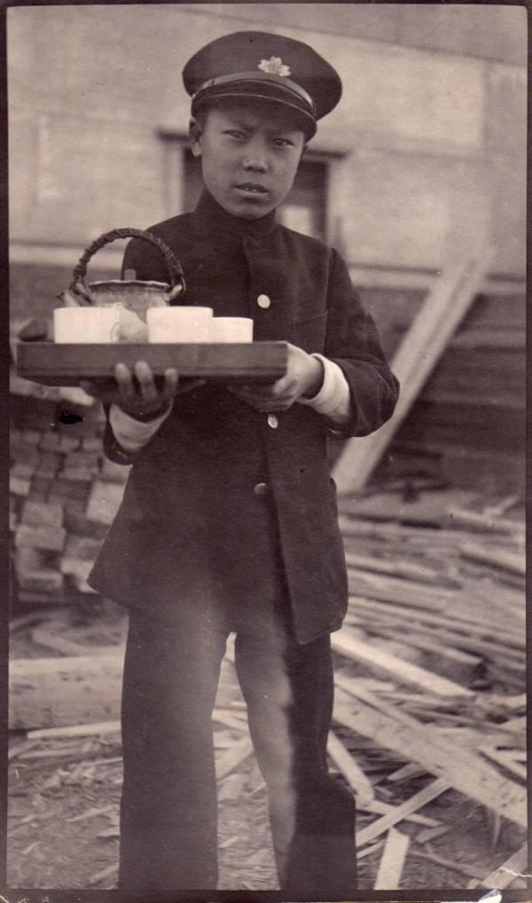 Korean Boy Serving Tea