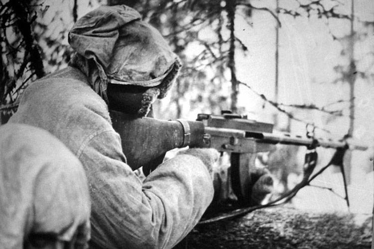 Finnish soldier aims his gun in the Winter War.
