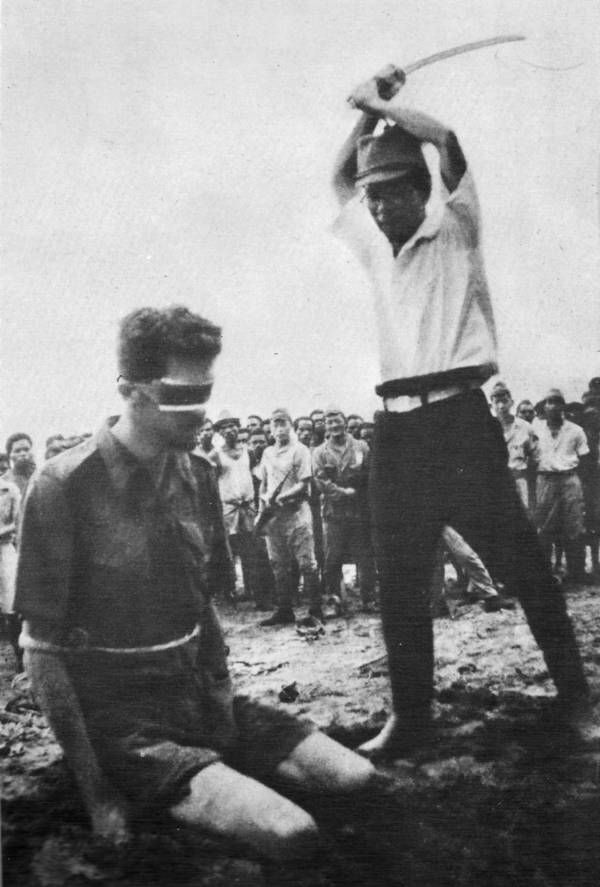 A bound American POW about to be beheaded with a sword