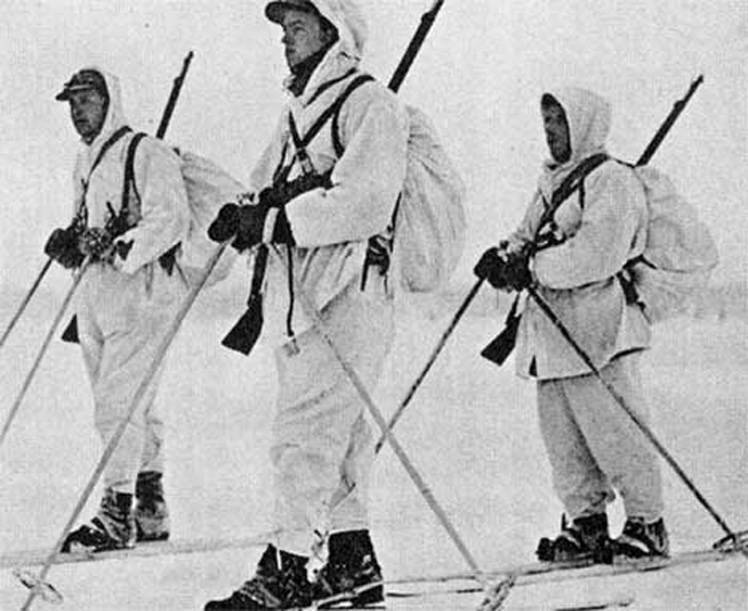 Norwegian volunteers on skis.