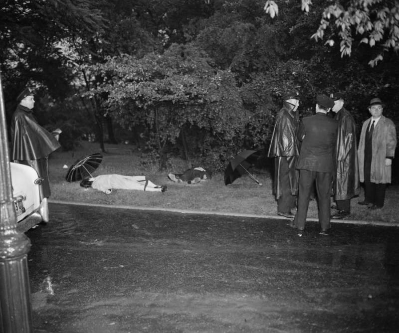 Policemen Investigating A Crime Scene