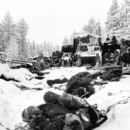 Soviet equipment and bodies of Red Army soldiers lie in the snow .
