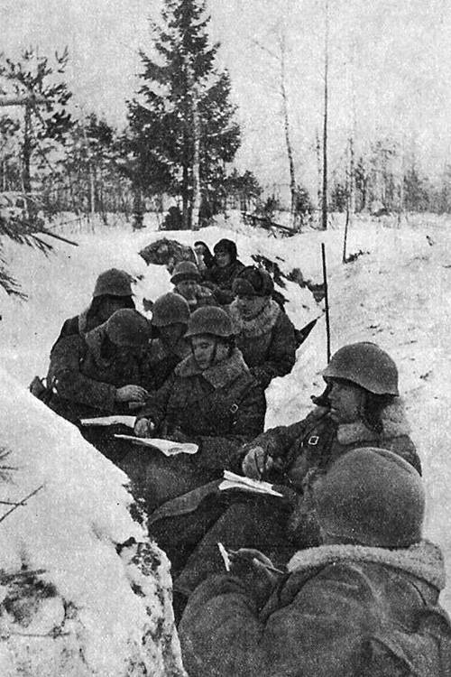 Red Army soldiers in a snow trench.