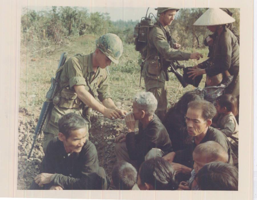 Soldiers Lights Civilian's Cigarette