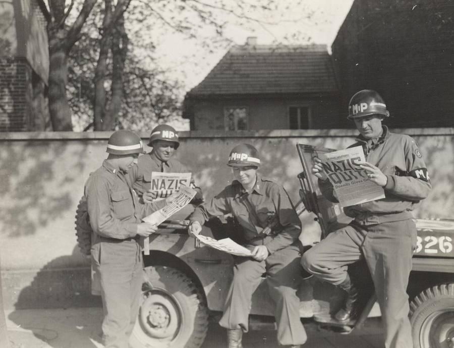 Soldiers Read Newspaper