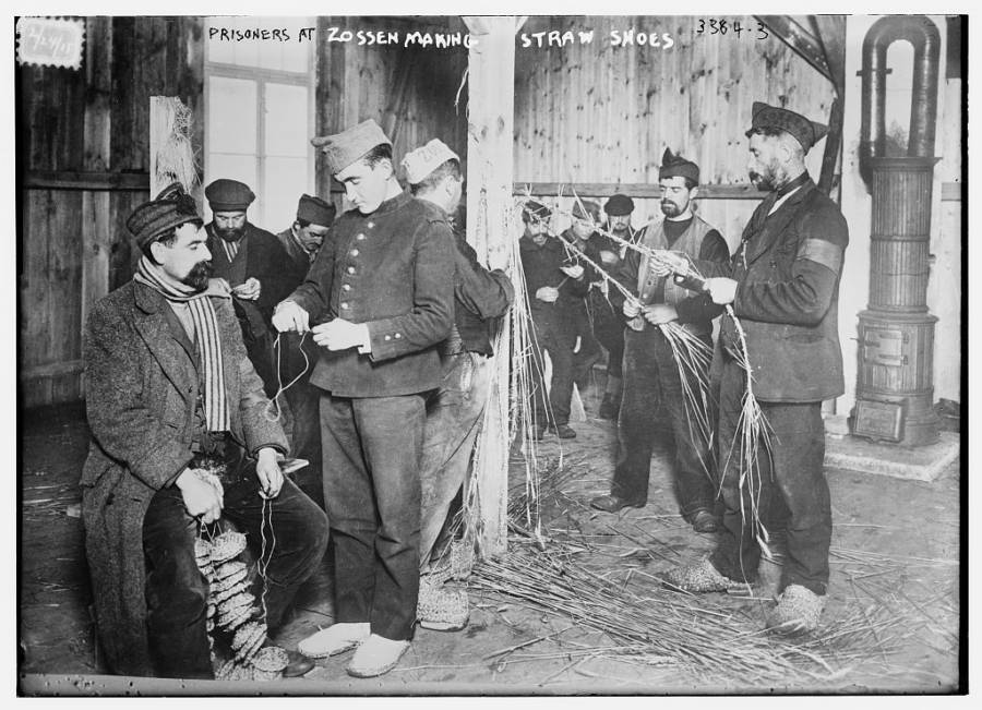 POWs making straw shoes