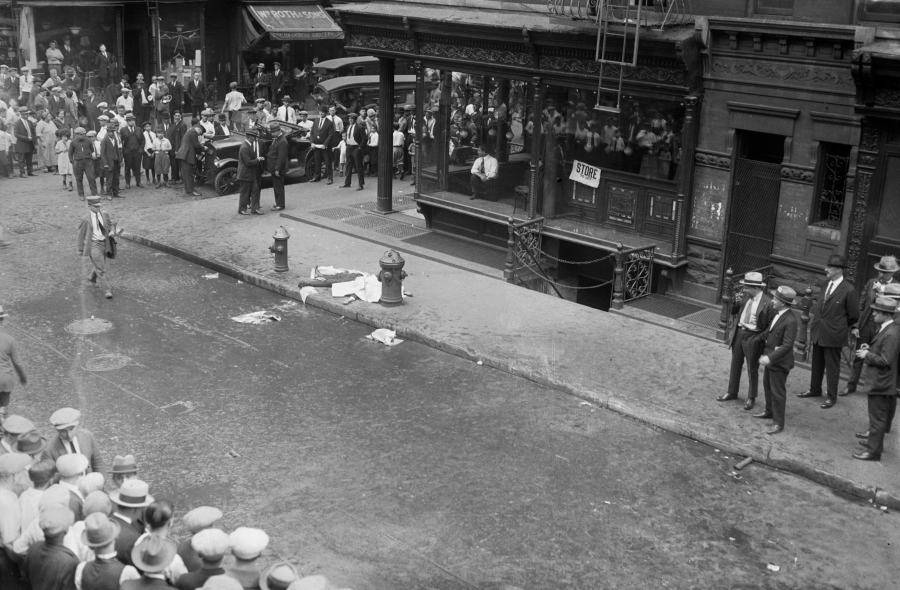 Victim Lying In Street Citizens Nearby