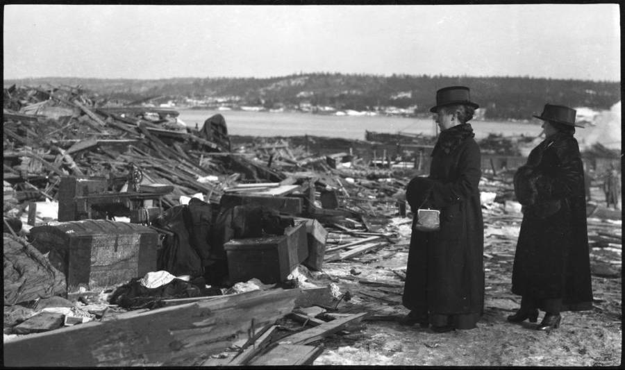 Women Looking At Debris